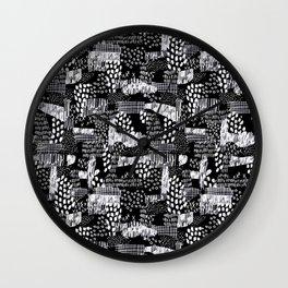 white on black drawn pattern Wall Clock