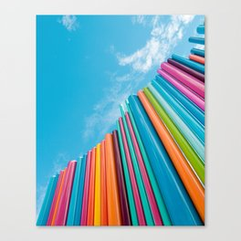 Colorful Rainbow Pipes Against Blue Sky Canvas Print
