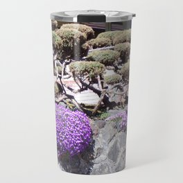 Rock Retaining Wall With Beautiful Trees and Purple Flowers Travel Mug