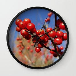 Winterberries glow against a blue autumn sky Wall Clock