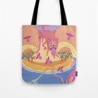 monkey island Tote Bags featuring monkey by mleko