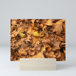 Leaves of dry autumn trees. Brown tones Mini Art Print