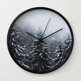 Fog over snow covered spruce forest in winter Wall Clock