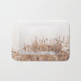 Typha reeds at frozen lake Bath Mat