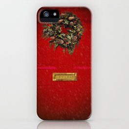 Christmas decorative wreath hung on red Victorian door with winter snow. iPhone Case