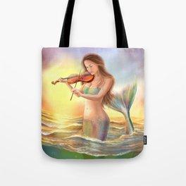 Beautiful woman fantasy mermaid plays on violin on sunset Tote Bag