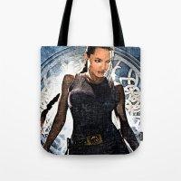 lara croft Tote Bags featuring Angelina Jolie as Lara Croft by Brian Raggatt