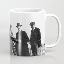 Crash Test Dummy! - Man testing football helmet on the wall of a house black and white photograph Coffee Mug