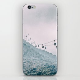 Cable car on a misty mountain high up iPhone Skin