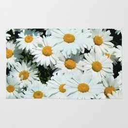 Daisies explode into flower Rug