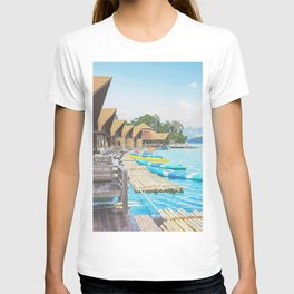 Peaceful boathouse, canoe boats, and blue water T-shirt