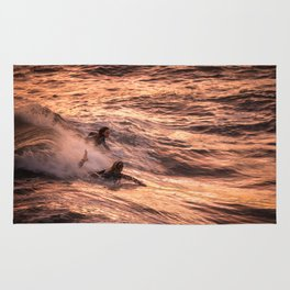 Girls catching a wave together Rug