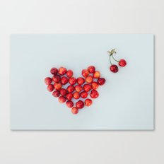 Heart of the ripe red juicy cherries on the white background. The view from the top. Canvas Print