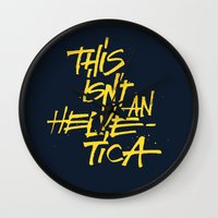 "helvetica Wall Clocks featuring ""Helvetica"" Lettering by Srg44"
