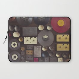 Music. Vintage wall with vinyl records and audio cassettes hung. Laptop Sleeve