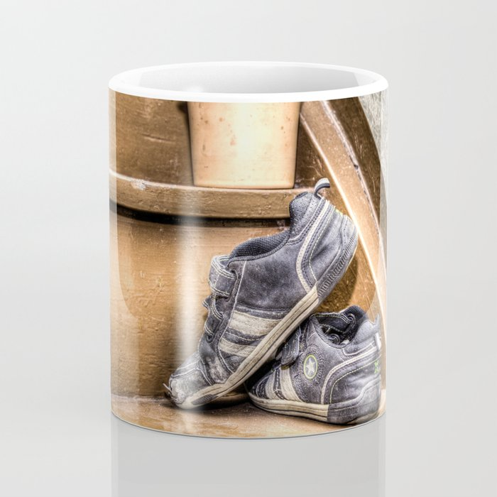 Old children's shoes on a stairway Coffee Mug