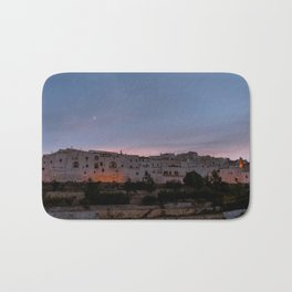 Panoramic view of the medieval white village of Ostuni at sunset blue hour Bath Mat