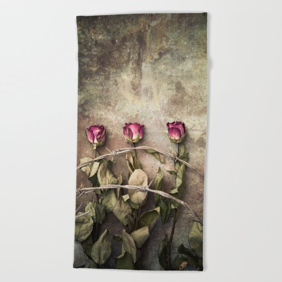 Three dried roses and barbed wire Beach Towel