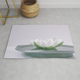 white lotus flower in a green bowl; wisteria white background Rug