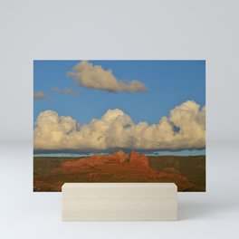 red rocks and a big cloud Mini Art Print