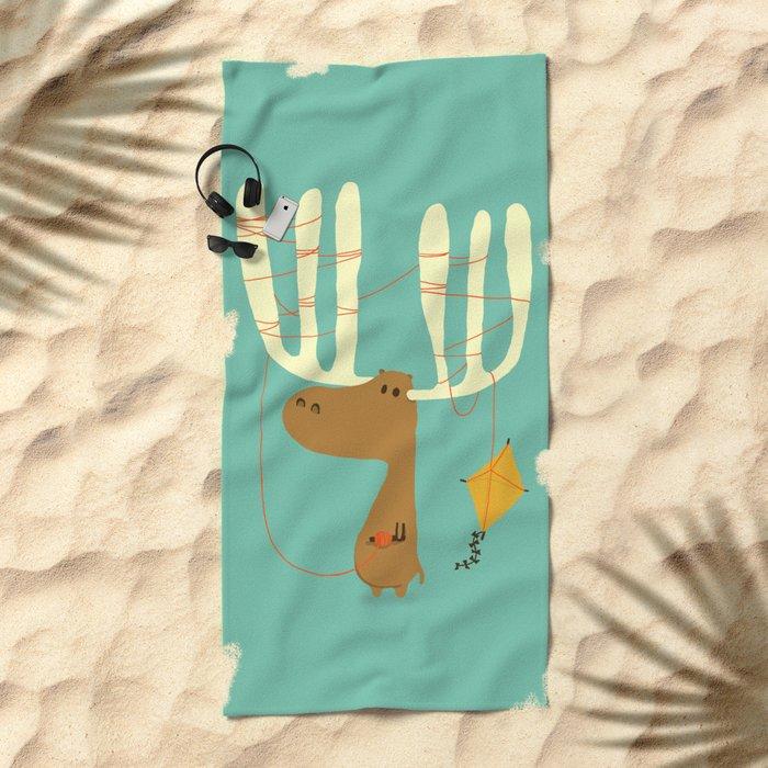 A moose ing Beach Towel