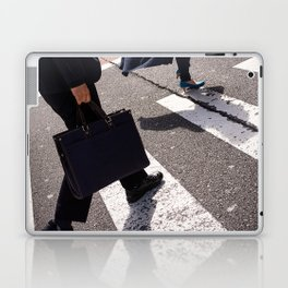 Group of businessmen and women walk along crosswalk in Shinjuku, Tokyo, Japan Laptop & iPad Skin