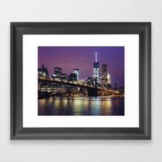 Manhattan Skyline over the Brooklyn Bridge at Night Framed Art Print