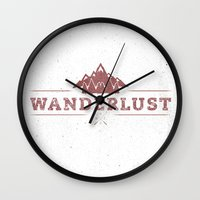 wanderlust Wall Clocks featuring WANDERLUST by magdam