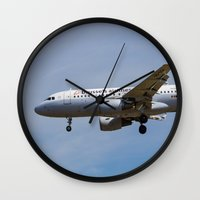 brussels Wall Clocks featuring Brussels airlines Airbus A319 by David Pyatt
