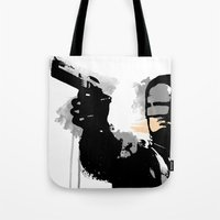 robocop Tote Bags featuring RoboCop by Molnár Roland