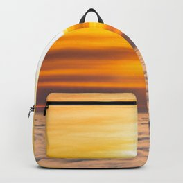 Stunning sunset above the clouds Backpack