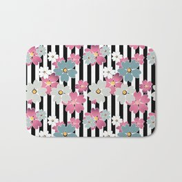 The floral pattern on striped background. Bath Mat