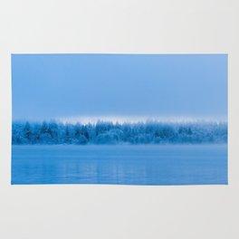 Mysterious fog over snowy lake Bohinj, Slovenia Rug