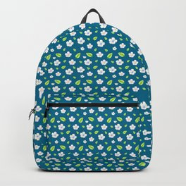 The pattern of apple flowers. Delicate apple or cherry flowers on an azure background. Backpack