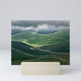 The hills of Castelluccio during a thunderstorm Mini Art Print