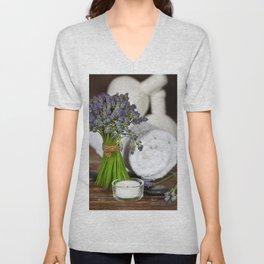 Fresh  lavender flowers, zen stones,Herbal massage balls , candle and towel over wooden surface Unisex V-Neck