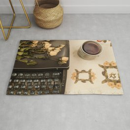 Little roses over an old typewriter and tea (Retro and Vintage Still Life Photography) Rug