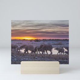 Elephant Herd at Okaukuejo Waterhole at Sunset Mini Art Print