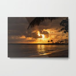 Sunset at the beach. Some palm trees against the light. Metal Print