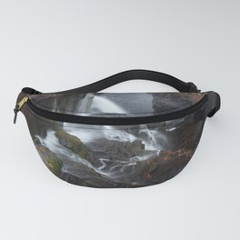 Waterfall over rocks with moss and leaves Fanny Pack