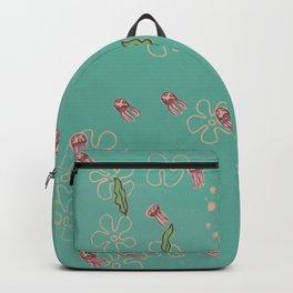 Jellyfish swimming through seaweed Backpack