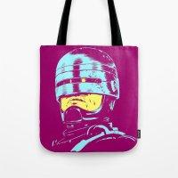 robocop Tote Bags featuring Robocop (neon) by Liam Brazier