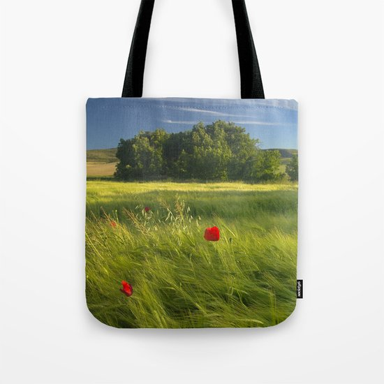 lonely poppies at the fields Tote Bag