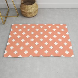 White Swiss Cross Pattern on Coral background Rug