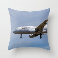 brussels Throw Pillows featuring Brussels airlines Airbus A319 by David Pyatt
