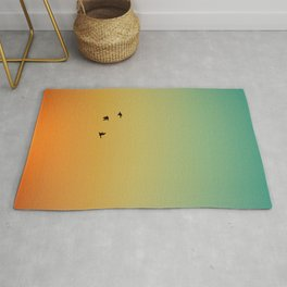 SILHOUETTE OF BIRDS FLYING DURING SUNSET Rug