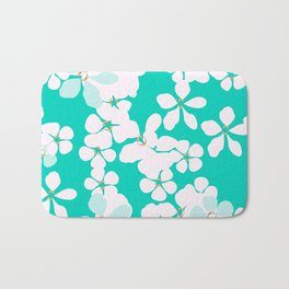 White and blue flowers with gold core on turquoise background Bath Mat
