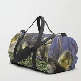 Baby geese on the waters edge Duffle Bag
