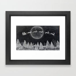 Santa flying over a winter wonderland of snow covered trees in his reindeer drawn sleigh by the light of a full moon Framed Art Print
