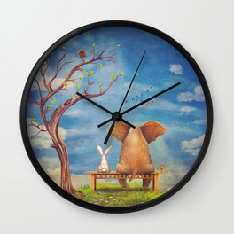 Elephant and rabbit sit on a bench on the glade Wall Clock